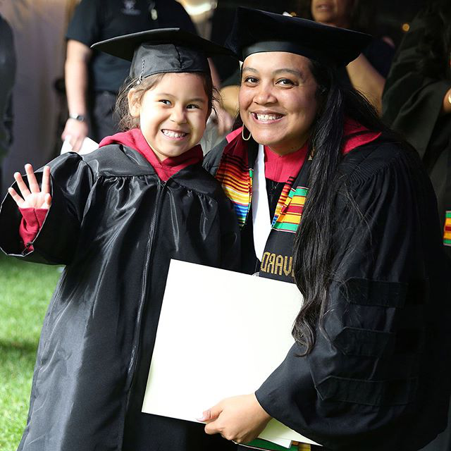Graduate with her child