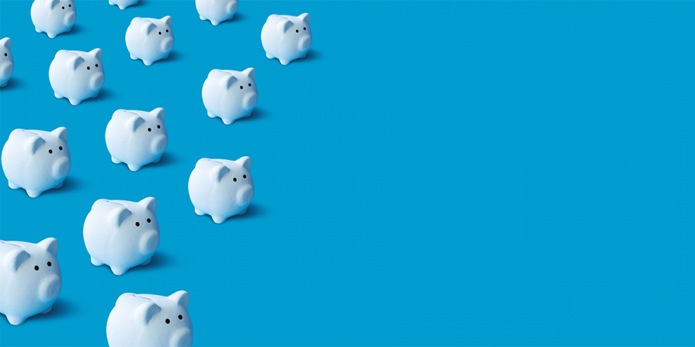 Piggy banks on blue background